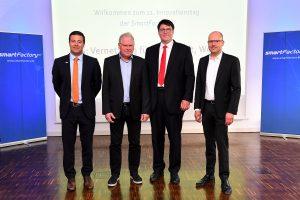 Die Referenten (v.l.n.r.): Prof. Dominik Durner, Dr. Hermann Buitkamp, Dr. Martin Verlage, Prof. Martin Ruskowski. Foto: SmartFactory-KL/ K. Schäfer